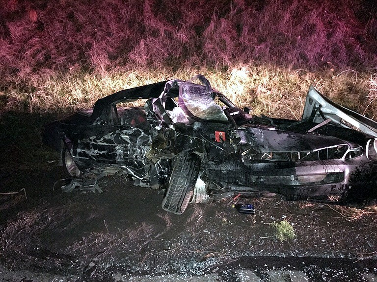 WRECKED CAR remains after a crash Tuesday evening on Highway 35 south of Hood River.
