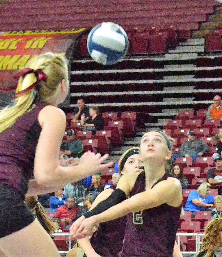 Kristen Broersma and Krista den Hoed keep their eye on the ball as Knights teammate Sailor Liefke bump sets it in Thursday's match against Colton.