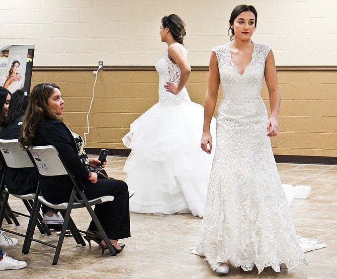 Bridal gowns from Fashion Corner captured the attention of the more than 50 people who attended the bridal workshop Sunday. Wedding and quinceañera attire for the entire party was featured during the show.