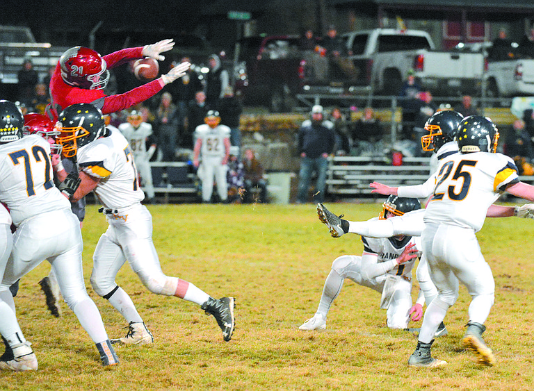 Jordan Jessee blocks a field goal attempt by Naches Valley in a state 1A game Nov. 10.