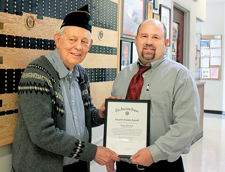 Fred E. Hayes Post 1st Vice Commander Dudley Brown, left, presents Daily Sun Publisher Roger Harnack with the Fourth Estate Award during the Veterans Day Brunch on Nov. 11 in Grandview