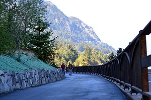 "Walkers enjoy the Columbia River Historic Highway State Trail west of Hood River. Photo Oregon State Parks is waiving the day-use fee to 26 state parks Nov. 25 to celebrate ""Green Friday,"" one of which is Rooster Rock State Park, located in the Gorge."