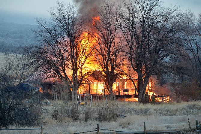 Fire crews from Omak, Okanogan and Malott responded shortly before 7 a.m. to a fully engulfed house fire on Omak River Road on Friday, Nov. 17.