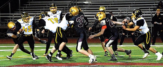 The Sunnyside Christian defense overruns the Panther offense to get to running back Colton Hansen.