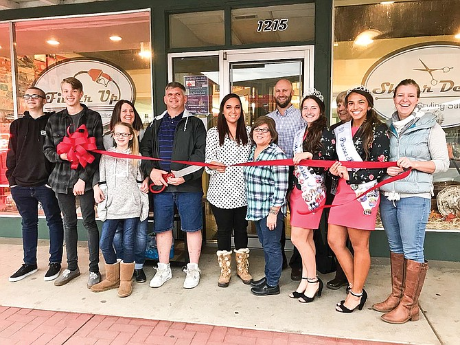 A Chamber of Commerce ribbon cutting at Shear Delight and Filler' Up Antiques and Collectibles in downtown Prosser, included, left to right: Nate, Noah, Shelley, daughter, and John Dixon, stylist Darleen Chavez, stylist Rosie Montelongo, Chamber board member Nick Cox, Miss Prosser Natalie Munoz, Chamber board member Deb Heintz, Miss Prosser Princess Camryn Hernandez, and Chamber Director Larelle Michener.