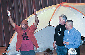 """Mel Skahan enlists help from the audience to re-enact his camp encounter during the """"Sasquatch & Spirituality"""" lecture at the Discovery Center on Nov. 10."""