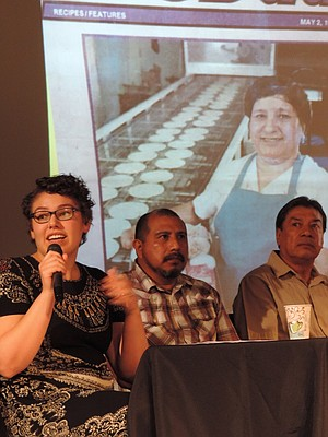 """'THERE are widely different amounts of privilege' in the Latino community, said Lisa Muñoz, left, at Sense of Place. With her are fellow panelists Ubaldo Hernandez and Eduardo Bello in front of a projected images of Gorge Latinos, including Juana Dominquez of Juanita's. Muñoz, a Lewis and Clark College graduate who currently manages Dog River Coffee, spoke along with Mexican-born Gorge residents Bello and Hernandez at the """"Sense of Place"""" forum, facilitated by Dr. Lynn Orr, executive director of the Hood River History Museum, and Oregon State University's Natalia Maria Fernandez."""