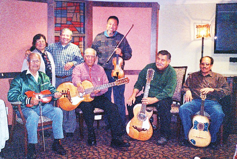 From left to right, the Old Time Fiddlers are: original member Victor Campos, singers Mr. and Mrs. David Loyola, original member and leader Fernando Farias, Rafael Mendoza, Reymundo Rivas and David Lepez. Unavailable for the picture was Heriberto Mendoza.