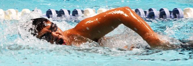 Junior Kobe Nishi practices his stroke earlier this week.