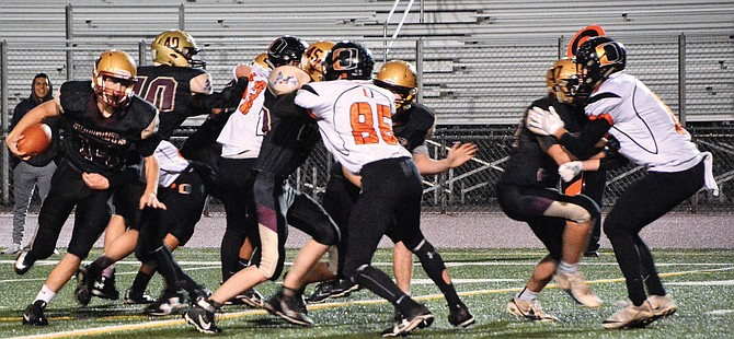 Chance Marsh, far left, runs the ball behind the Knights offensive line.