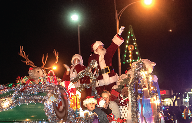 Santa brings Christmas greetings to the downtown corridor, where he will be giving sleigh rides through the season.
