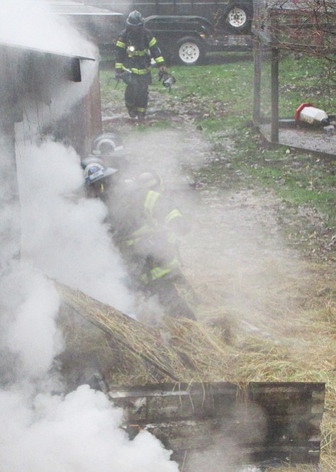Firefighters battle a barn fire that started on Saturday on Oakdale Road.