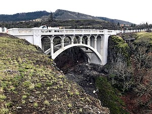 DRY CREEK BRIDGE on Highway 30 is being fixed up, part of a repair and replacement project by Oregon Department of Transportation of three bridges west of Mosier. Minor work will continue for a few weeks before the full job is done.