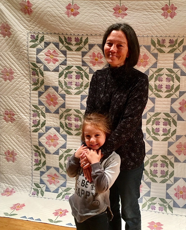 QUILT winner Brenda Wilson, with her granddaughter. Half of the raffle proceeds were donated to the Meals on Wheels program.