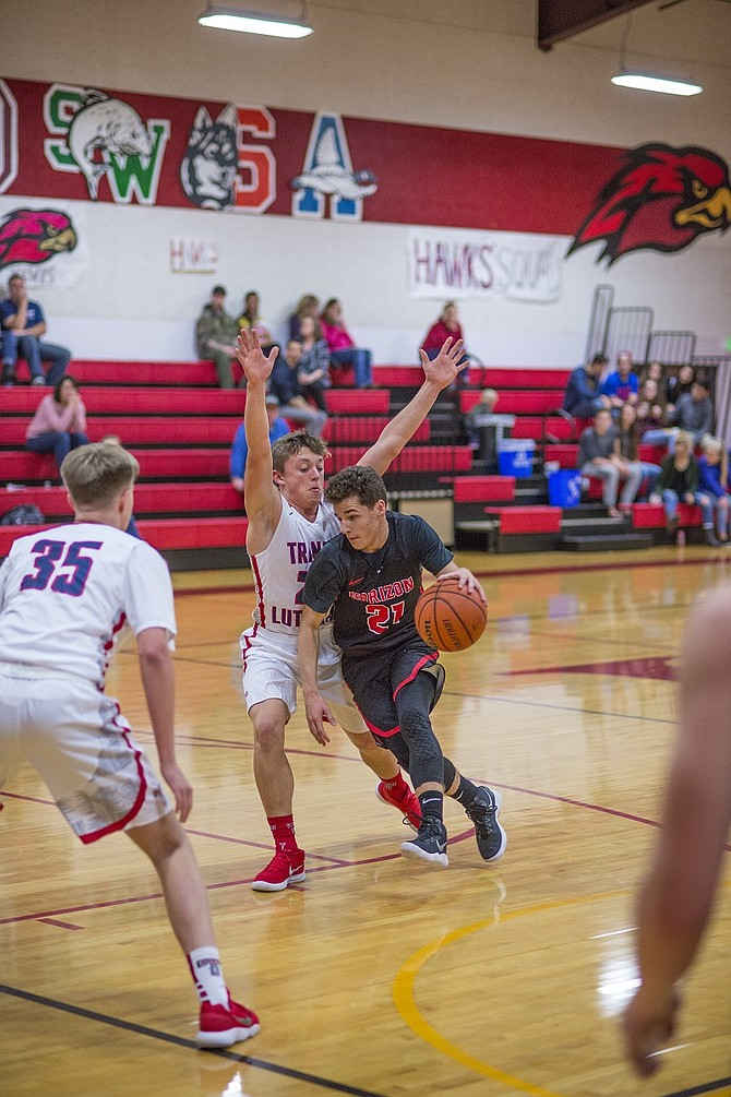 Horizon Boys basketball over the weekend went 1-1 in the Hawks Invitational tournament. In the two games freshman guard Caleb Lingel (21) scored 22 against Damascus and 13 versus Trinity.