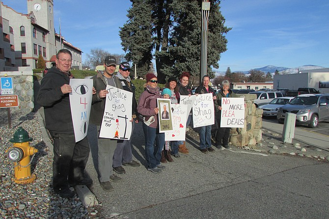 Picketers gather Monday afternoon outside the Okanogan County Courthouse while suspect Jared Nathanael Fudge is in courtroom for arraignment.