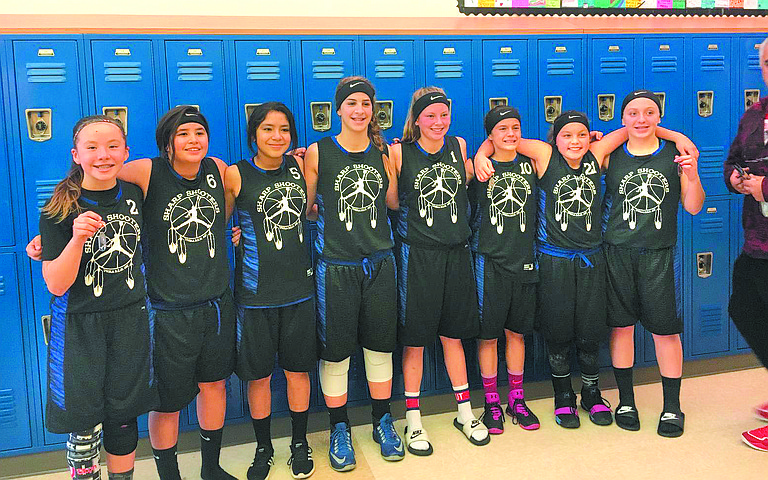 Alana Seymour/Special to The Chronicle An Okanogan County Sharpshooters seventh grade girls' basketball team went 5-0 and took first place at the Veterans Day tournament Nov. 11-12 in Wenatchee. The girls hail from Omak (5), Bridgeport (1), Lake Roosevelt (1) and Cashmere (1). They included (from left) Halle Albert, Arela Nanpuya, Lesli Moreno, Cameron Phillips, Sedeaju' Michel, Alyssa Davis, Aaliyah Marchand and Sawyer Steffens.