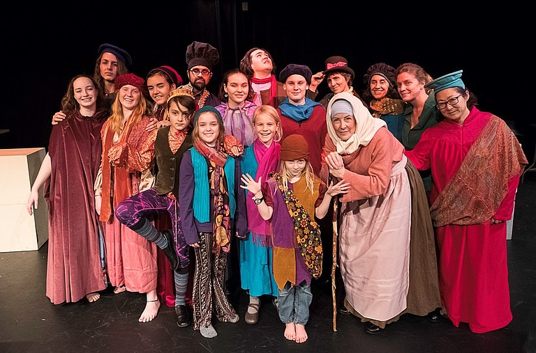 STREGA NONA (Desiree Amyx-Mackintosh, with cane) and a large cast fill the stage with the beloved Tomie Paola story set in an Italian village.