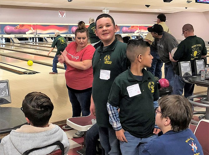 Noah Rios, 14, of Sunnyside stands among the more than 40 local competitors at last month's Special Olympics regional bowling tournament in Richland.