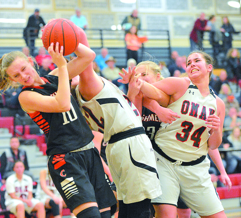 Omak's Kristi Marchand tangles with Cashmere's Grace Hammond, left, going for a rebound during Dec. 5 game. At right is Omak's Jamie Utt (24).