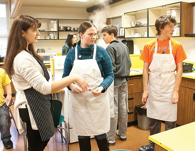 Kelleigh Ratzlaff instructs students during a cooking course at Dallas High School.