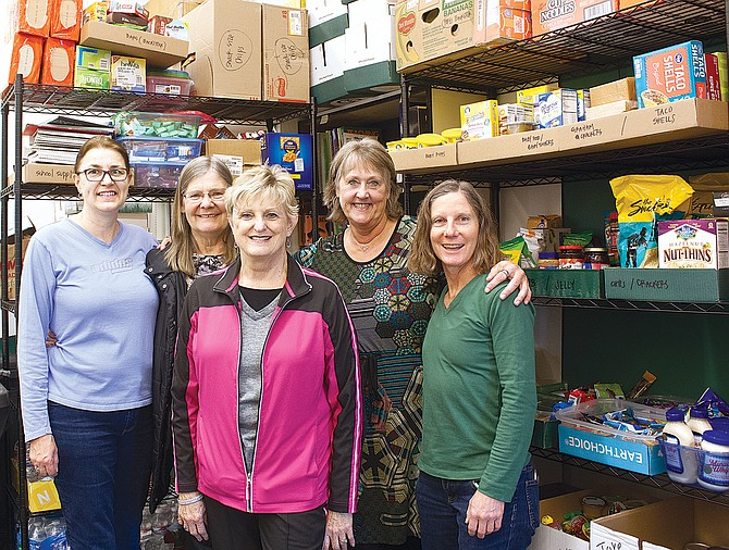 """Debbie McCleery, fourth from left helped create a food pantry for older students to """"shop"""" at every Friday."""