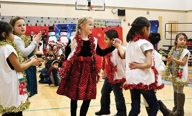 A happy scene was repeated through the Lower Valley this past week, as schools celebrated the season and the coming of winter break in song and dance. Outlook Elementary School first graders entertained family and friends last Thursday at their first concert.  Other schools throughout the areas have also held winter concerts.