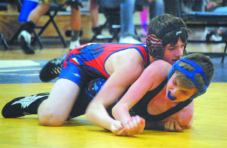 Troy Wood of Tonasket (top) takes on J.J. Walker or Republic/Curlew at NOHI tournament.