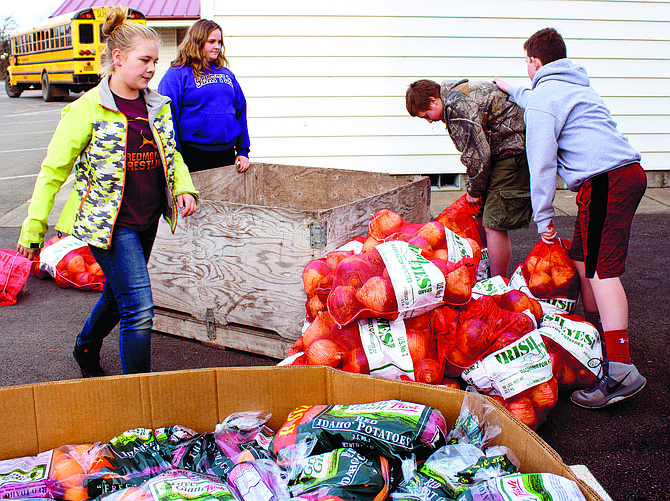 Students with Perrydale FFA put together food pallets to distribute to Oregon's hungry this Christmas.