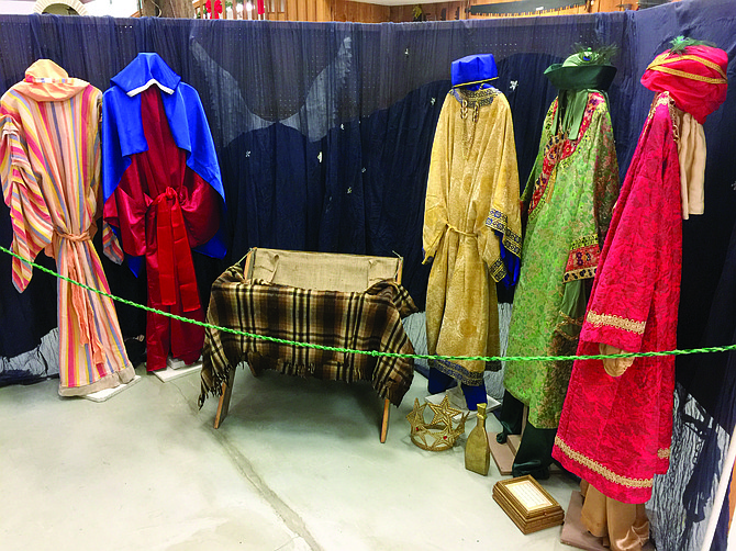 Costumes from the Rickreall Pageant are carefully hung to show the story of the birth of Jesus Christ.