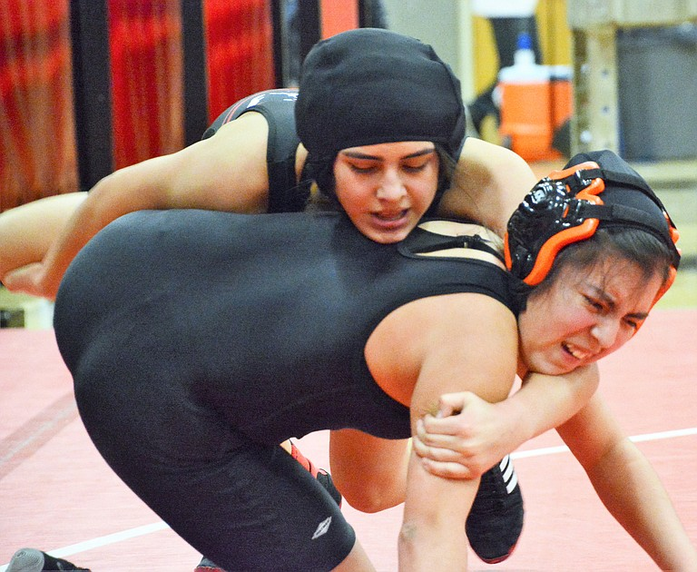 Sunnyside's Briana Nieto wraps up a Cashmere wrestler before pinning her in the 130-pound weight class.