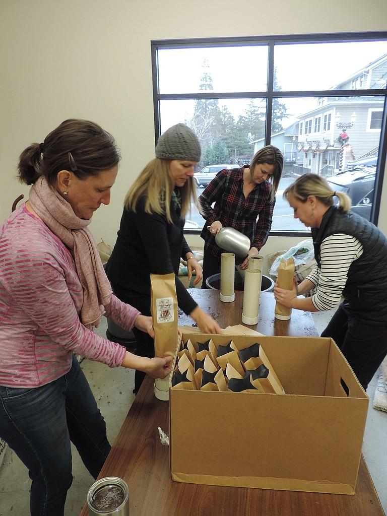 PARENTS Sarah Marsden, left, Kristen Kellner, Carmen Tuttle, and Melissa Martin bag coffee at Pacific Rim.