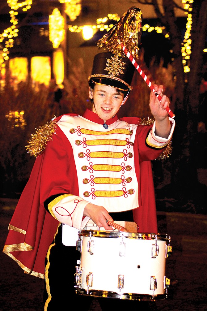"""A drummer plays during the nightly performance on """"Snowflake Lane"""" in Bellevue. The 7 p.m. showing turns into """"Celebration Lane"""" tonight and continues through New Years in front of Bellevue Square Mall."""