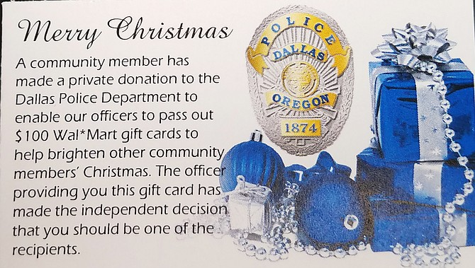 Dallas police officers handed out 50 $100 gift cards to families in need this holiday season thanks to an anonymous donation.