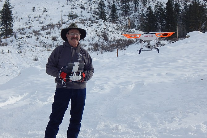 Monty Archer flies his drone which takes pictures and 4K high-definition video.
