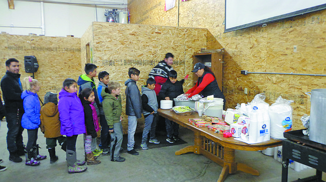 Children seize the opportunity for tamales at The Armory in Brewster, where the Las Posadas procession was finally granted shelter from the cold.