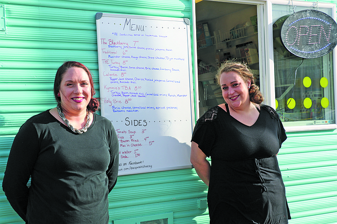 Owners Nicole Turner and Kymmie Mills share their cheesy creations at The Speak Cheezy food truck.