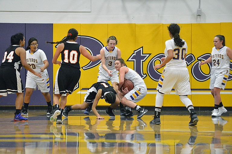 Sara Poole of Pateros comes up with a loose ball at holiday tournament Dec. 28 at Pateros. Also pictured are Anna Williams (3) of Pateros and Monica Trejo (1) of Bridgeport.