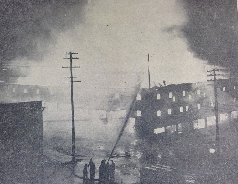 Hood River's fire department, aided by Bingen and White Salmon brigades, were able to hold conflagration within the high concrete walls of the Apple Growers Association's packing plant, one of the largest in the country, after battling the blaze for more than seven hours. All concede that a large section of the business district had a narrow escape in what was Hood River's most costly fire. — H.R.N. Photo-Engraving