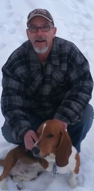 Thomas Paul Willner poses with Lucky, a three-legged Basset Hound who died in the Dec. 23 fire at 305 Magers St. in Twisp.