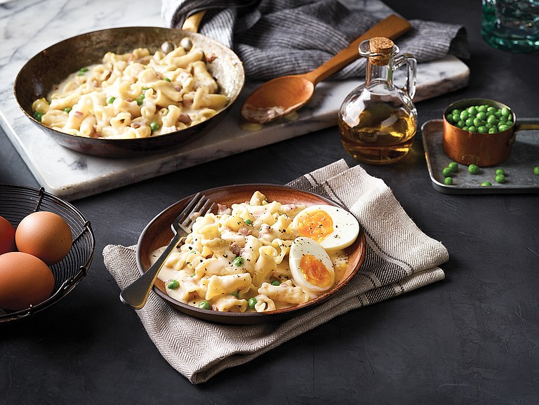 Warm up the family on cold days with Campanelle with Prosciutto and Peas in creamy Alfredo sauce.