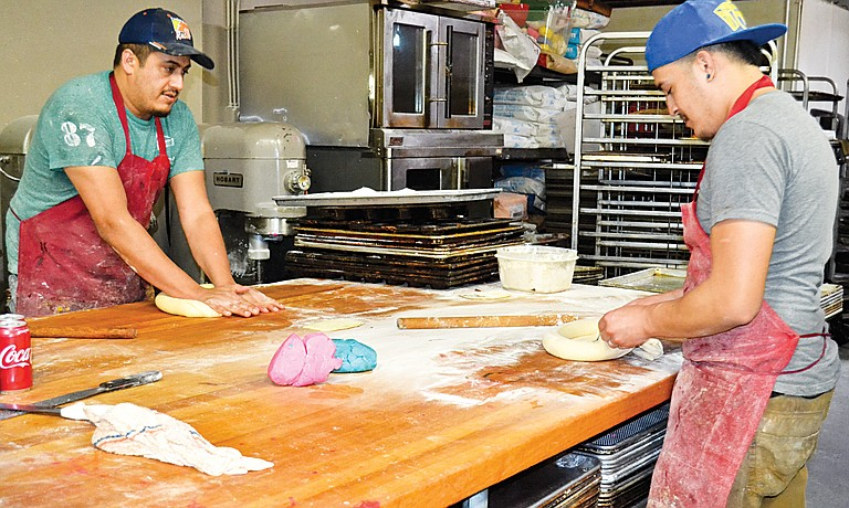 Brothers Manuel Cortez and Mario Cortez, who work for their brother Jose Cortez, owner of Pepe's Bakery, start working on Roscas de los Reyes, a bread with which many families celebrate the arrival of the three kings.