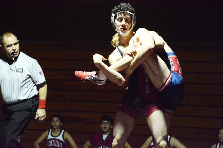 Grandview's Kenneth Plaza and Ellensburg's Ryker Freeman grapple in last night's dual match.