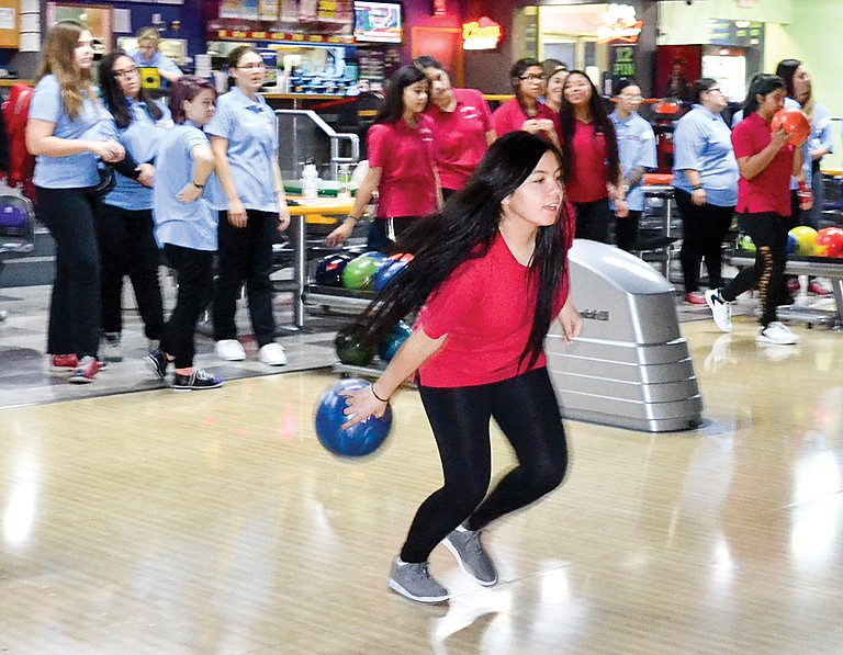 Ariana Madrigal approaches the lane in last night's bowling match against West Valley (Yakima).