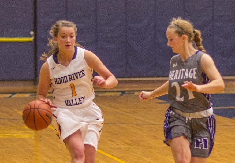 HRV Girls basketball on Wednesday, Jan. 3 went on the road and edged out St. Helens by a final score of 41-40. The girls were led in this game by junior guard Haylee Baker (above) who ended the night with 14 points, seven assists and six rebounds. Senior forward Lauren Orr (pictured below) was the only other double-digit scorer for HRV with 10 points. Orr also added nine rebounds and a block versus St. Helens.