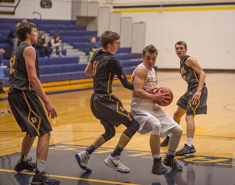 HRV Boys basketball lost 50-40 at home to St. Helens on Jan. 3. Peiyton Slatt (above) had nine points and Carson Orr (pictured below) had four.