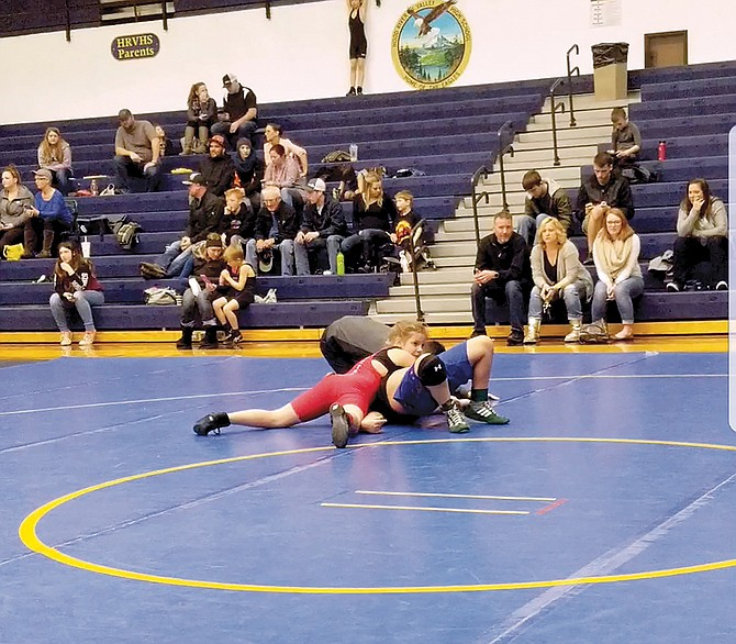 Tyanna H. pins an opponent at the Hood River tournament on Saturday. Tyanna finished second, while Diego Pena placed third.