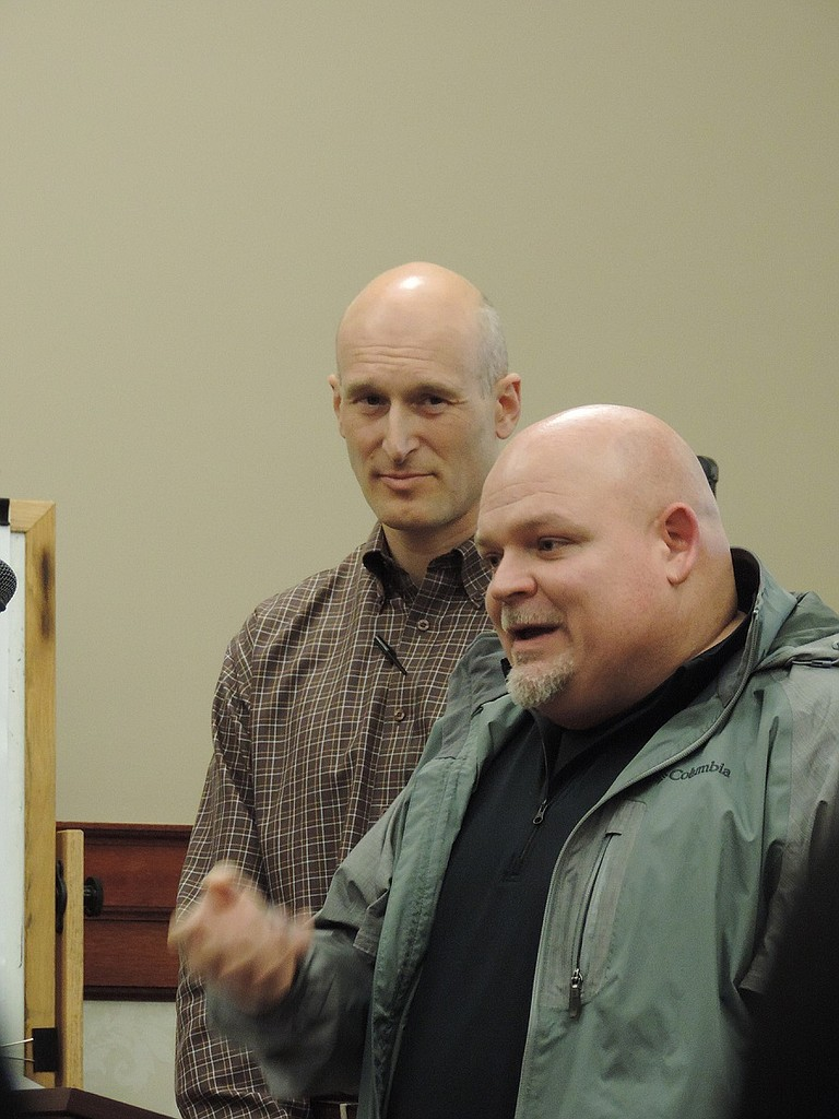 POLICE chief Neal Holste, right, tells City Council he supports the ID card concept; with him is GEM's Mark Thomas.