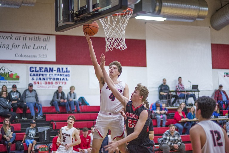 Hot shooting continues for junior forward Derek Johnston as he put up 22 points in the Hawks 51-47 victory over Dufur last Saturday night. Johnston also tallied five assists and three steals.