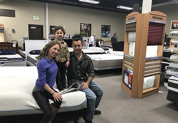 OWNERS Ronelle Masters and her husband, Alejandro, pose with their son, Aleron, at the new Downey Sleep Center in Hood River.